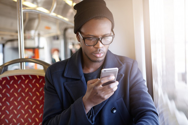 Citizen on bus using digital transport management app